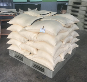 After milling rice is bagged up, stacked and is ready for resting.